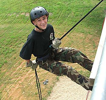 Joshua Carr, Missouri Wing, Rappeling at the 2007 Missouri Wing Summer Encampment while serving as a Flight Commander. Photo credit: 1st Lt. Jennifer Carr